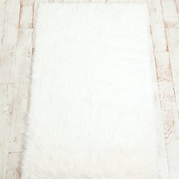 Faux Sheepskin Rug - White has never been as cozy as it is in this rug. This faux sheepskin will be heaven underfoot.