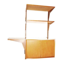 """CADO - Pre-owned CADO System Royal Wall Unit - A stunning, 1960's CADO shelf system. A two door cabinet with interior light, 2 teak free-standing poles, 6 teak and walnut brackets, 2 teak shelves, and 1 shelf/desk extension, all in excellent condition.    This amazing well preserved unit can be use all together as a floating desk with shelves. Or, let  the desk can be stand on its own with a teak base. All shelves are stamped """"Made in Denmark"""". Designed by Poul Cadovius and produced by System Royal.    Other Measurements:  2 Shelves: 28.5""""W x 15 """"D  6 Brackets: 18.25"""" W  1 Cabinet: 32""""W x 18.5""""D x 20""""H  1 Free Standing Base: 32""""W x 18.5""""D x 7.5""""H  1 Shelf/Desk Extensions: 18.5""""W x 15""""D  2 Poles: 44""""H"""