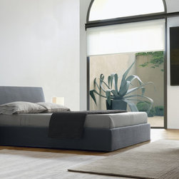 Roger Bed - Roger Bed is designed by crj. Completely upholstered bed with removable fabric or in leather, available with or without storage.
