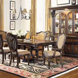 Fairmont Designs - Dining - The Grand Estates offers fine dining with graceful European style conveying Old World elegance. Beautiful primavera veneers are highlighted with delicate inlays of walnut, enriched by a radiant and lustrous finish. Richly detailed corbels enhance the styling of the casual dining base, server and china. Photo: Fairmont Designs