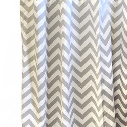 """New Arrivals - New Arrivals Curtain Panel Set Zig Zag - Finish the room in style with curtain panels in artful colors and prints by New Arrivals. Accented with soft gray tabs, the Zig Zag curtain panels are a modern and chic design featuring a chevron pattern in gray and white. Designed to coordinate with New Arrivals nursery and children's bedding. Optional standard or blackout curtain lining is available for an additional cost. Set of 2 curtain panels in Zig Zag Slate. Each panel measures 52""""W x 84""""L (not including ties). Length of curtains can be customized by contacting shop@laylagrayce.com. Handmade in the USA. Due to its custom nature, this order is a final sale"""