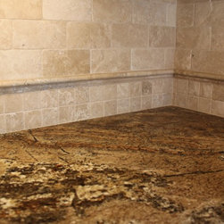 Tumbled travertine backsplash with granite - Tumbled travertine tile full height backsplash with granite counter-tops.