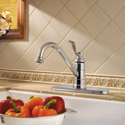 Pfister - Pfister Portland GT34-1P0 Single Handle Kitchen Faucet - 519859 - Shop for Kitchen from Hayneedle.com! Hints of classic design let the Pfister Portland GT34-1P0 Single Handle Kitchen Faucet come to life in style to transform your kitchen. The curving lines are constructed from solid brass to battle against bacteria and corrosion with ease. You won't have any trouble getting those large pots and pans into the basin with its high-arcing and swiveling spout. Just give the single handle a tug and twist for smooth operation that leaves one hand free for multitasking. A trusty ceramic disc valve guarantees that this faucet won't drip even years down the line.Product Specifications:Mount Type: Deck MountHandle Style: LeverValve Type: Ceramic DiscFlow Rate (GPM): 2.2Swivel: 360 degreesSpout Height: 5-inchSpout Reach: 10.3-inchAbout PfisterPfister has been one of the most trusted names in the plumbing industry since they opened their doors in 1910. Since then they have created a legacy of excellence in design and engineering that has made them an innovative leader in the industry creating superior kitchen and bath faucets fixtures and accessories. They are continually exploring ways to meet eco-friendly standards and user-friendly products that cater to the needs of our environment.