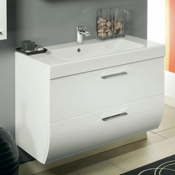 Iotti - 2 Drawers Vanity Cabinet with Self Rimming Sink - Soft round lines play a lead role in the furnishing line. New Day – wrap-around and reassuring, is ideal and pleasant for a comfortable environment. Made in Italy. High end ceramic sink made in Italy. Faucet not included. All drawers feature soft-close runners. The engineered wood vanity is made with waterproof panels. Single vanity features 2 drawers. Top of the vanity comes in a white finish.