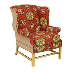 Pre-owned Wingback Chair in Orange Batik Cotton Fabric - Unlock your style with this wingback chair upholstered in bold orange and yellow vintage Batik cotton. This retro textile, retrieved from an estate sale, features a fabulous lock and key motif. Finished with brush fringe and gilt gold legs.
