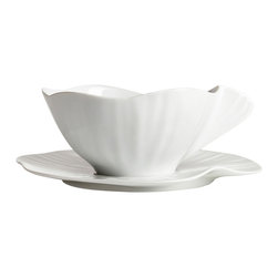 Jacques Pergay - Lotus Porcelain Coffee Cup and Saucer - The delicate Lotus leaf takes a new immortal life in this elegant design by Jacques Pergay. Whether you're serving a multi-course dinner or dishing up fresh stir fry for two, this collection will add a dash of charm to your dinner table.