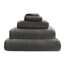 """Design Within Reach - DWR Aerocotton Towels - Made of 100% Turkish cotton, these towels are crafted using an innovative spinning process that creates ultra-soft and wonderfully plush material. In addition, this process creates a larger surface area for the yarns, which translates into superior absorbency for you. DWR Aerocotton Towels (2011) are woven into a nice 700-gram weight (not too heavy, not too light) and then combed for extra softness. In keeping with a simple, modern aesthetic, there is no """"dobby"""" or decorative banner around these towels, and the functional tag doubles as a hanger. Even after repeated washings, these towels retain their fluffy appearance and soft touch. Machine washable. Made in Turkey. DWR Exclusive"""