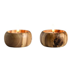 Olive Wood Tea Light Holders - Tea lights are always lit in my house. These ones are fancy! I'm all about natural wood, and these would be the perfect, and simple, way to dress up plain tea lights.