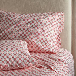 Genevieve King Sheet Set - Classic geometric quilting pattern updates in sunny coral and white as a sunny, streamlined graphic by London designer Genevieve Bennett, printed on soft cotton percale. Scaled-down motif coordinates beautifully with boldly patterned Genevieve bed linens. Sheet set includes one flat sheet, one fitted sheet and king pillowcases. Bed pillows also available.