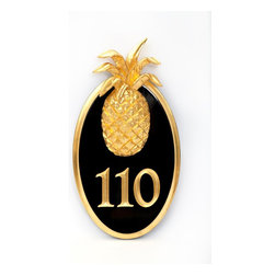 Oval House Number With Large Pineapple - A simple yet glamorous house number plaque in striking black and gold is the perfect way to set the tone for what's inside the front door.