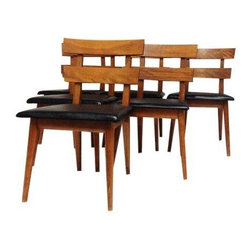 Pre-owned Mid-Century Modern Chairs - Set of 6 - A set of Mid-Century Modern chairs with black cushions. This set of 6 will have your guests sitting in Vintage Danish style. Unique thick planks on the ladder back design.