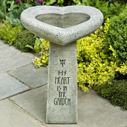 Campania International My Heart is in the Garden Bird Bath - What We Like About the My Heart is in the Garden Bird Bath The My Heart is in the Garden Bird Bath is a charming way to show your appreciation of your feathered friends. The large heart-shaped bowl is perched on an elegantly inscribed pedestal. Crafted from cast stone, this bird bath is designed for years of enjoyment. A selection of natural finishes complement any outdoor setting.About Campania InternationalEstablished in 1984, Campania International's reputation has been built on quality original products and service. Originally selling terra cotta planters, Campania soon began to research and develop the design and manufacture of cast stone garden planters and ornaments. Campania is also an importer and wholesaler of garden products, including polyethylene, terra cotta, glazed pottery, cast iron, and fiberglass planters as well as classic garden structures, fountains, and cast resin statuary.Campania Cast Stone: The ProcessThe creation of Campania's cast stone pieces begins and ends by hand. From the creation of an original design, making of a mold, pouring the cast stone, application of the patina to the final packing of an order, the process is both technical and artistic. As many as 30 pairs of hands are involved in the creation of each Campania piece in a labor intensive 15 step process.The process begins either with the creation of an original copyrighted design by Campania's artisans or an antique original. Antique originals will often require some restoration work, which is also done in-house by expert craftsmen. Campania's mold making department will then begin a multi-step process to create a production mold which will properly replicate the detail and texture of the original piece. Depending on its size and complexity, a mold can take as long as three months to complete. Campania creates in excess of 700 molds per year.After a mold is completed, it is moved to the production area where a team 