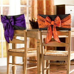 Halloween Chair Bows - I love the idea of wrapping a simple, colorful bow around the back of a chair to make your Halloween party feel extra special.