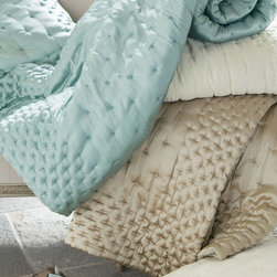 Adagio Comforter - A luxurious layer of glamour for the bed, our Adagio comforter is a celebration of sumptuous texture. Start with the fabric: Sublime to the touch, it's washed down for a rich, lustrous sheen and an amazing hand that's softer than silk. Dotted with embroidered stitches for a dimensional puckered effect, it's exquisitely finished on all sides with a tightly quilted lattice border. Exceptionally light and lofty, this comforter has a wonderful, season-spanning versatility that marries beautifully with many other bedding collections. Crafted of polyester with poly fill, it reverses to a soft cotton backing. Coordinates with the Adagio Bed Sham (sold separately). In tranquil shades of ivory, taupe or pearl blue.