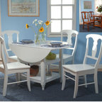 """TMS - Cottage 5 Piece Dining Set - Features: -Set includes dining table and four dining chairs. -White finish. -Constructed of solid wood, MDF and rubber wood. -Table includes two drop leaves that expands serving surface to 48"""". -Includes two bottom shelves. -Chair features urn style back. Dimensions: -Dining table dimensions: 30.75"""" H x 26-48"""" W x 48"""" D. -Dining chair dimensions: 38.25"""" H x 17.5"""" W x 18.25"""" D."""