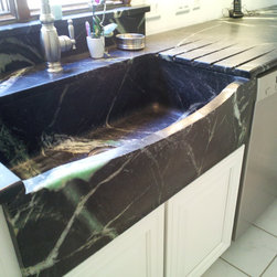 """Carved Soapstone Sink - This is our 30"""" bowed front carved soapstone sink.  This elegant sink is made out of grey soapstone and it can be match with a contrasting counter top or the same stone.  Not sure about the size?  We can create a sink to fit exactly what your project needs.  The turn around for this piece of art is only two weeks.  Do not worry about shipping its on us.  This sink is also available in white marble and black soapstone with less veining."""