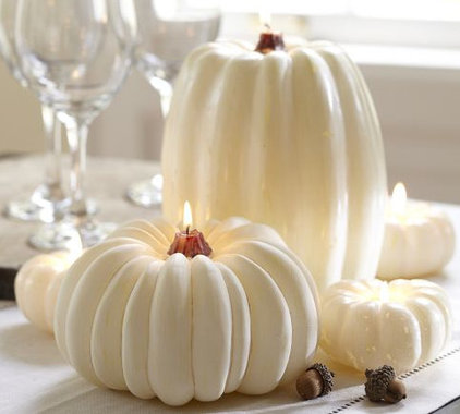 candles and candle holders by Pottery Barn