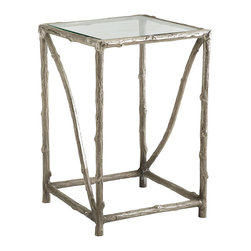 ILLUMINATING ALUMINUM SIDE TABLE - NEW - First appearing in pottery from Ancient Egypt and once considered to be a precious metal, aluminum is the most common metallic element on Earth. The faux-bois open design keeps things airy, and with a glass top this table provides the elbow room without the bulk. A nickel-plated finish updates its look and gives it an illuminating flair.