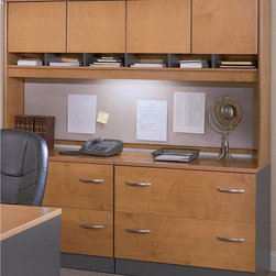 Bush Furniture - Bush Series C Double Lateral File and Hutch - BHI409 - Shop for File and Storage Cabinets from Hayneedle.com! If you have a lot of files to keep track of but would like attractive additional storage the Bush Series C Double Lateral File and Hutch is just for you. The lateral file cabinet is perfect for storing your letter legal and A4 file folders. Two drawers open on full-extension ball-bearing slides for smooth movement and a single gang lock with an interchangeable core locks both drawers and affords privacy and versatility. The file cabinet's interlocking drawers reduce the likelihood of the unit tipping and levelers provide stability on uneven floors.The hutch attractively extends your storage space with a fully finished back panel and a convenient fabric-covered tack board allows you to easily keep track of notes and messages. Two cabinets offer storage and an open center shelf is perfect for storing binders or displaying collectible items. European-style self-closing adjustable hinges help keep cabinet door movements smooth and ensure that the doors stay closed.This unit has a durable scratch-resistant finish in your choice of wood tones and it includes a 10-year manufacturer's warranty. Choose from the following finishes to best match your office or home decor: auburn maple Hansen cherry light oak mahogany mocha cherry or natural cherry. Assembly required. Overall dimensions: 70.984W x 23.346D x 72.834H inches.About Bush FurnitureBush Furniture is the eighth-largest furniture company in the United States. Bush manufactures high-quality products which are designed to be easily assembled and provide great value for the price. Bush furniture is made from a combination of particleboard fiberboard and solid wood components. The use of real wood components will be noted in the product description if applicable.Bush Industries has more than 4 million square feet of manufacturing warehousing and distribution space. This allows for a very wide select