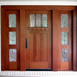 "Craftsman Doors - This Craftsman Door is was designed to go on the remodel of a Craftsman Cottage in Auburn, Alabama.  This entry is built out of Mahogany.  Doors By Decora designed the door and glass similar to some of Frank Lloyd Wright's designs.  The 36"" X 84"" door and matching 20 1/2"" sidelites have square sticking.  The custom shelf and dentil add detail while the Baldwin Richland hardware completes the look."