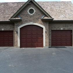 Various Installs - Clopay Premium Ultra Grain Series style steel door. Installed in Wadsworth by Overhead Garage Door, Inc.  1-888-459-3720.