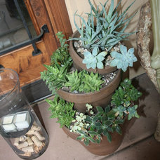 Mediterranean Outdoor Pots And Planters by Belle Terre Landscapes