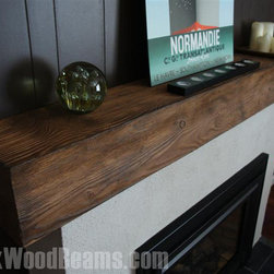 Fireplace Mantels - Bring the beautiful lines and grain pattern of wood into your fireplace design without all of the hassles of the real thing. The fireplace mantel shelf shown here is a molded replica but will last longer than the real thing, is more resistant to warping & splitting, and is pest resistant as well.