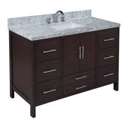 Kitchen Bath Collection - California 48-in Bath Vanity (Carrara/Chocolate) - This bathroom vanity set by Kitchen Bath Collection includes a chocolate cabinet, soft close drawers, self-closing door hinges, double thick Italian Carrara marble countertop (an incredible1.5 inches thick at the edge!), undermount ceramic sink, pop-up drain, and P-trap. Order now and we will include the pictured three-hole faucet and a matching backsplash as a free gift! All vanities come fully assembled by the manufacturer, with countertop & sink pre-installed.