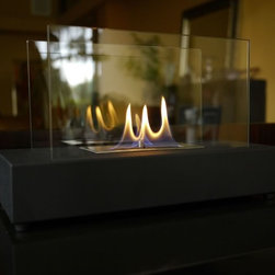 Incendio Tabletop Bio Ethanol Fireplace by Nu-Flame - Incendio, with its sleek, open design, is ideal for creating emotional decor. Providing a 360 degree view of the dancing flame, Incendio provides comforting warmth in a small space or patio. This fireplace offers an eco-friendly flame that is odorless. Bio Ethanol, an alternative fuel source produced from plants, only emits water vapor and carbon dioxide into the air. Although ethanol fireplaces aren't intended for use as a primary heat source, the Incendio model produces some heat that will change the ambient temperature in a small space. For aesthetic appeal and safety, this fireplace includes two panes of tempered glass, positioned on the long ends, that frame the flame and provide the unobstructed view. Appropriate for any living space, Incendio's base is offered in a black powder-coat.