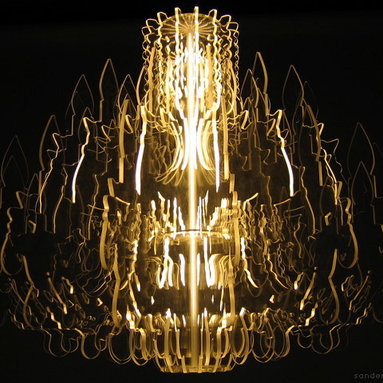 "Eco Friendly Furnture and Lighting - Made from 16 transparent contours illuminated by a fluorescent bulb, this chandelier provides a modern reincarnation of the traditional chandelier. Through the use of special materials and accurate CNC milling techniques the whole body of this fixture emits a magic light. Together with table lamp ""Marie-Louise"" and floor lamp ""Josephine"" this sophisticated design is part of a series of unique lighting fixtures, which are guaranteed eye catchers in any interior."