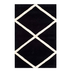 Safavieh - Celestia Hand Tufted Rug, Black / Ivory 2' X 3' - Construction Method: Hand Tufted. Country of Origin: India. Care Instructions: Vacuum Regularly To Prevent Dust And Crumbs From Settling Into The Roots Of The Fibers. Avoid Direct And Continuous Exposure To Sunlight. Use Rug Protectors Under The Legs Of Heavy Furniture To Avoid Flattening Piles. Do Not Pull Loose Ends; Clip Them With Scissors To Remove. Turn Carpet Occasionally To Equalize Wear. Remove Spills Immediately. A timeless quatrefoil motif makes a global design statement in the subtle but sophisticated Desai area rug. These stunning hand-tufted wool rugs are crafted in India to recreate the elegant look of hand-knotted carpets for today's lifestyle interiors.