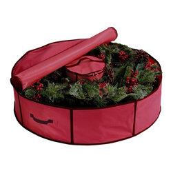 "Ricahrds Homwares - Holiday 36"" Wreath Bag with Center Storage - Prepare for the holiday season with this 36"" wreath storage bag. A wreath bag is a must have holiday decor organizer, simply place your favorite wreath in the bag, zip it up with double-pull zippers, and store it safely until next Christmas. A removable center storage bag fits neatly inside the stored wreath, perfect for keeping ornaments, ribbons and other wreath decorations close by. Made of vinyl-backed 600-denier polyester shell with wire side supports. The festive red color with green trim and id card holder make it a cinch to spot in the garage year after year."