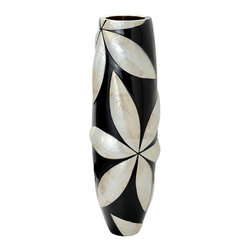 Kabibe Seashell Floor Vase - The Kabibe seashells are manually set to create large flower petals onto a black painted fiberglass vessel. Ideal for tall vines and plants like bamboo. This floor vase makes a stunning statement in narrow spaces that are difficult to fill.