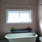 Bathrooms - Who says that you can't shower in a claw foot tub.  we installed this combo shower curtain and shower head just for this purpose.
