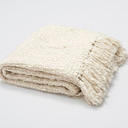"Metallic Knit Fringed Throw, 50 x 60, Ivory - An instant, dazzling way to dress up a sofa or bed, our throw has a little metallic thread interlaced into its chunky weave. 50 x 60"" Made from an acrylic/polyester blend. Hand-knotted fringe ends. Yarn dyed for vibrant, lasting color. Dry-clean. Imported."