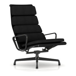 "Herman Miller - Herman Miller Eames Soft Pad Lounge Chair - Fabric - Stretch out in serious style with this amply padded lounge chair, perfect for catching a few zzz's, watching the big game or reading the latest bestseller. Designed by the iconic duo of Charles and Ray Eames, it's a quiet departure from those they typically created for the office environment. This lounge chair has a permanent recline and a longer back to give it a more ""stretched out"" feel."