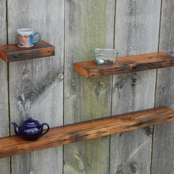 Three Chestnut Floating Shelves - Three reclaimed Chestnut floating shelves. Made from weather reclaimed rafters. Mellow golden and complex dark reds, browns, and blacks blend together for subtle color variation. Adds charm and warmth to any decor. Keyhole fasteners installed for easy, secure installation. Light coats of varnish.