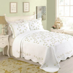 Peking Handicraft Inc. - Rosaria Bedspread - The Rosaria quilted bedspread is a truly modern heirloom. This vintage-style bedspread was designed the old-fashioned way with intricate stitching and is embroidered with delicate framed roses and scrolling vines in the softest vintage yellows and greens.