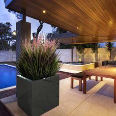 Modern Outdoor Pots And Planters by Decorpro Home + Garden