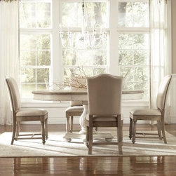 Riverside Coventry 5 piece Round Dining Set - Add casual, country charm to your dining room with the Riverside Coventry 5 pc. Round Dining Set. This set, which includes the dining table and four side dining chairs, is built from hackberry and birch hardwoods with ash veneer. It's finished in weathered driftwood and Dover white, and the finish is lightly distressed for an aged look. Each chair is upholstered in 100% linen, with hand-hammered nail head trim. The table includes an 18-inch extension leaf.About Riverside FurnitureRiverside has been growing for more than half a century. The company's founder, Herman Udouj, opened the doors to his first factory in 1946, and along with 12 employees, he began making handcrafted furniture for the post-World War II Baby Boom era. Since then, generations of customers have furnished their homes and offices with Riverside's wide range of furniture products. Riverside strives to be trusted for quality products that are an affordable value. It's just that simple.Notes on Riverside ConstructionAll Riverside domestic furniture is constructed of fine oak, ash, poplar, and pine wood. These wood types are durable and feature beautiful, open grains that make them much preferred among furniture manufacturers. Each piece of wood is first graded for quality, then kiln-dried to remove excess moisture and prevent splitting. The wood is then constructed into a high-quality furniture piece using a combination of hardwood solids and hand-selected veneers. Techniques used on Riverside pieces include dovetail joinery, heavy-duty drawer roller guides, and multi-step finish applications that include hand-sanding and polishing for a deep, lustrous result. All Riverside furniture is given this high-quality treatment to ensure the beauty and durability of your final product.