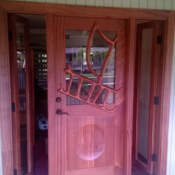 Carved Doors - Nice touch to have the side lights open. At nsdmill.com we can do what ever you want. We ship to all of the USA including Hawaii and Canada.