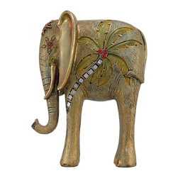 Hand Painted Golden Palm Tree Abstract Elephant Statue - This stunning hand-painted abstract statue is of a patchwork elephant, trunk raised high. The statue measures 10 1/4 inches high, 5 1/4 inches across and 2 1/2 inches deep. Made of cold cast resin, he has burnished golden ears, is finished in a gold wash, and is accented with red and green enamels, red rhinestones and tiny mirror tile pieces. It makes a great gift for friends and family.
