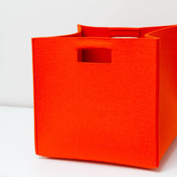 Design Storage Bin, XXL by Studio Big - The fastest, easiest way I've found to keep a home (relatively) neat with little ones underfoot is to always have plenty of bins and baskets on hand. These thick felt ones look perfect. They're easy for small hands to carry from room to room and come in a great modern shape.