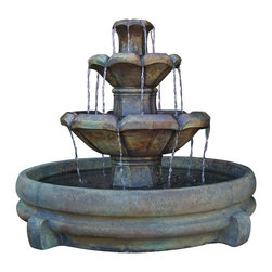 """Lamps Plus - Montreux Three-Tier Cast Stone Fountain - Classic form blends with elegant style in the Montreux three-tier fountain. Hand-crafted in genuine cast stone and finished in a rich earthly stained patina the design features a bottom pool and a top finial where water flows from basin to basin. A convenient submersible recirculating pump is included. Montreux three-tier fountain. Relic nebbia stain finish. Cast stone construction. Includes 15 feet of cord. 32"""" high. 36"""" wide. 36"""" deep.  Montreux three-tier fountain.  Relic nebbia stain finish.  Cast stone construction.  Includes pump and 15 feet of cord.  32"""" high.  36"""" wide.  36"""" deep."""