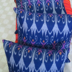 Ikat Pillows - Violet Blue with Orange and Fuschia - This colorful all cotton hand loomed Indonesian ikat  blends the feathery feel of an ikat with a crisper than usual geometric print.  100% cotton, hidden zipper.  Inserts have all cotton cover with 50% rayon fiber from bamboo.  Textiil LLC.