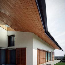 Volumetric House Integrating Wooden Elements ...