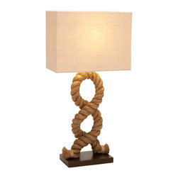Casa Cortes - Hamptons Nautical Rope Pier Metal Table Lamp - Sculptural in design and sturdy in craftsmanship, our Nautical Table Lamp combines fluid curves with a thick twist of marine-grade rope. Topped with a natural linen drum shade, this piece offers an organic look that brings the outdoors in.