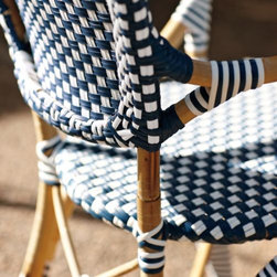 Serena & Lily - Riviera Armchair Navy - A classic 1930s European bistro chair, reinterpreted. Crafted by hand of sustainable rattan with woven plastic seats in always-chic navy and white, it's stylish and durable enough for all your dining destinations  from the breakfast nook to the patio. A near perfect match to our Riviera Side Chair, with just a slight variation in the way the colors are woven to keep things interesting.