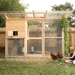 Walk-In Chicken Coop Plan by The Garden Coop - The Garden Coop company designs plans for chicken coops that you build yourself, making it far more cost-effective than most ready-made coops on the market. The one shown here is the largest they offer: It includes plans for a coop with a large, enclosed run and a person-sized door for easy cleaning and care.