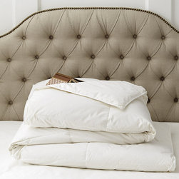 Ballard Designs - White Goose Down Comforter - Loops to accommodate duvet covers with ties. 600 fill power white goose down. 230-thread count 100% cotton. Machine washable & dryable. This luxurious White Goose Down Comforter is finely made by the same American company the supplies the world's best hotels and resorts. White goose down is cocooned in crisp Cambic cotton and quilted end-to-endwith box sewn-thru construction.White Goose Down Comforter features:. . . .